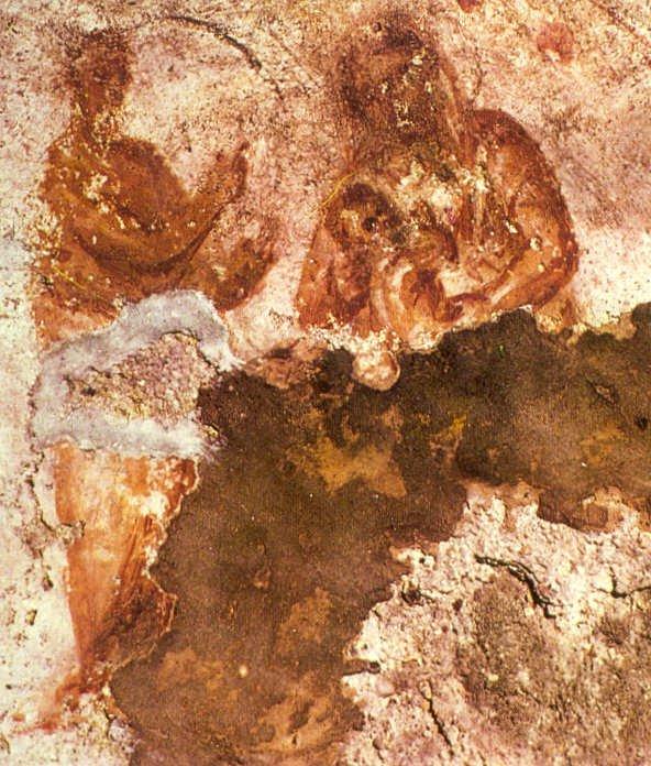 arte cristã primitiva exibindo imagem de maria e menino jesus em catacumba