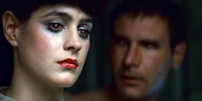 Deckard e Rachel em close exbindo os olhos com pupilas brilhantes